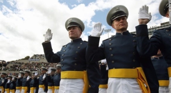 Cadets take the oath of office during  graduation ceremonies at the U.S. Air Force Academy in Colorado Springs, Colorado