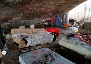 An area under a Wilmington, Delaware bridge where a group of homeless people stay.