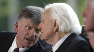 Franklin Graham talks to his father, Billy Graham, at the Billy Graham Library dedication service in Charlotte, North Carolina, in May 2007.
